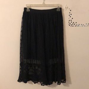 Mid length black lace skirt
